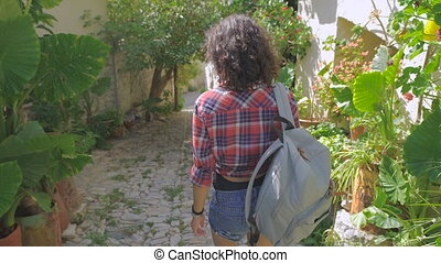 Cheerful woman wanderer with trendy look searching direction...