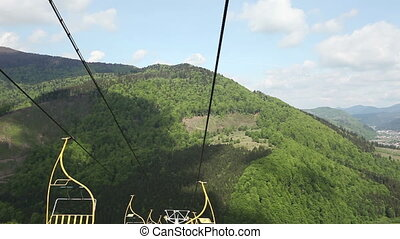 Ski lift riding - Breathtaking mountain scenery is seen on a...