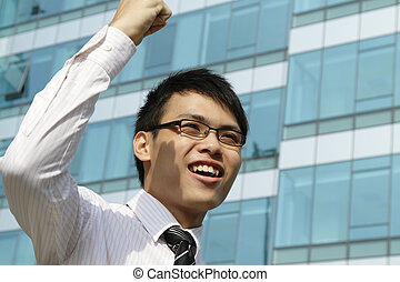 A victorious executive waving his fist