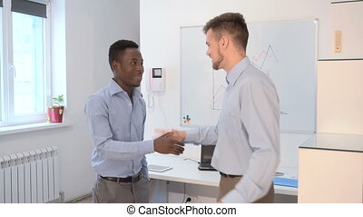 businessman talking in office - two businessman talking in...
