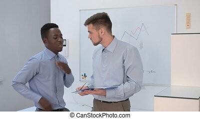 businessman talking in office - two businessman talking in...