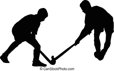 Silhouette of boy hockey players battling for possession of...
