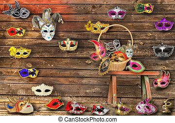 Carnival masks hanging on wall boards lie on floor and bench...