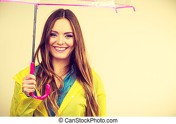 Woman wearing waterproof coat under umbrella - Woman rainy...