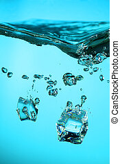 Ice cubes with bubbles - Ice cubes falling into a water on...