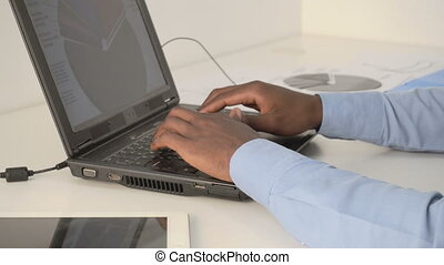 male hands typing on laptop keyboard - Closeup of male hands...