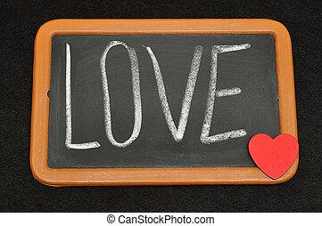 Blackboard with the word love written on it