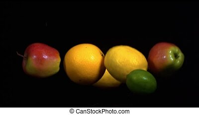 Fruits in slow motion on a black background