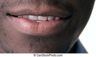 Closeup of man smiling. - Closeup of African American man...