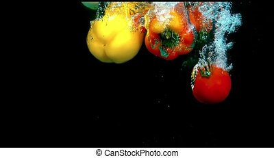 Fruit in water on a black background