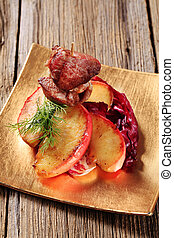 Roasted meat and apple - Roasted meat on stick and slices of...