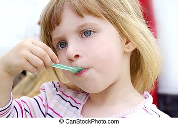 blond little girl eating ice cream portrait - blond little...