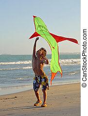 little cute boy, sunset at the seacoast with kite, adorable...