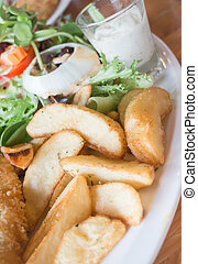 Gourmet fish and chips with salad