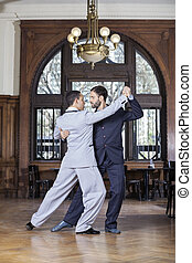 Partners Performing Argentine Tango In Restaurant - Full...
