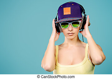 radio broadcaster - Modern young woman enjoys listening to...