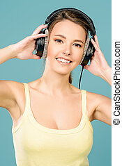 love music - Modern girl enjoys listening to music in...