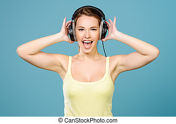 expressive girl - Modern girl enjoys listening to music in...