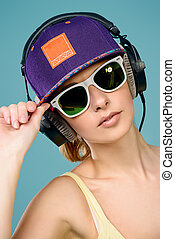 female in headphones - Modern young woman enjoys listening...