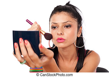 Beautiful woman applying makeup - Close up of a beautiful...