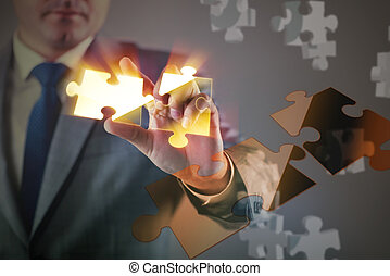Businessman in business concept with puzzle piece