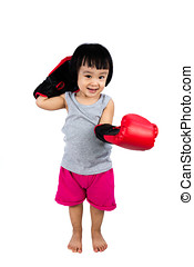Asian Little Chinese Girl Wearing Boxing Glove in isolated...