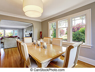 Open floor plan dining room with table set and hardwood...