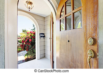 Nice bright entry way to home with concrete porch area