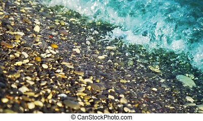 Waves lapping agains a pebble beach with very shallow depth...