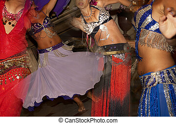 Belly dance background - Composition of young girl dancing...