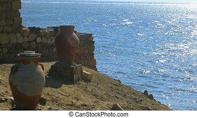 Calm ocean with blue sky and amphora . - Calm sea with blue...