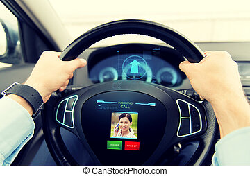 close up of man driving car with incoming call - transport,...