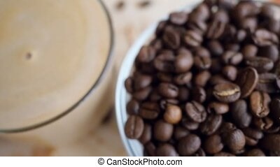 Camera shift slowmotion at bowl with Coffee beans and...