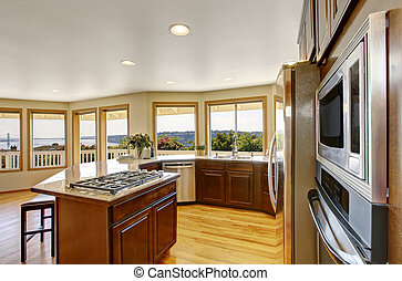 Modern kitchen room interior with many windows and perfect view.