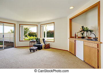 Living room with leather armchair and exit to balcony