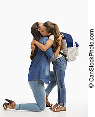 First day of School - Mother hugging her little daughter and...