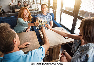 Group of friends celebrating something - Cheers. Cheerful...
