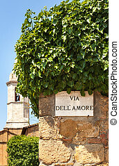A sign on the wall in Pienza town. Italy - The streetsign of...