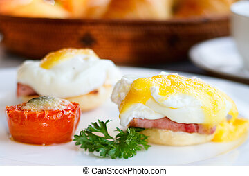 Delicious breakfast Eggs benedict with ham on toast