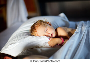 Morning - Adorable toddler girl in bedroom at the morning