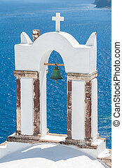 Old bell tower over the sea in Santorini