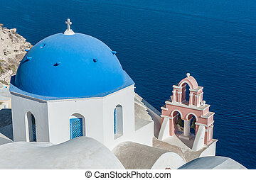 Orthodox church with blue dome over the sea in Santorini