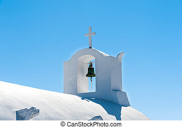 White top of a orthodox church in Santorini - Greece