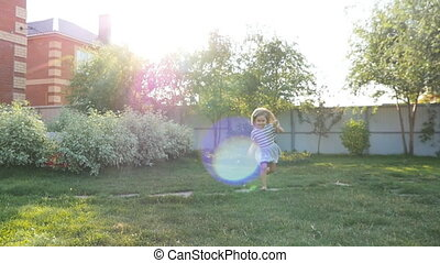 Young happy girl running at grass
