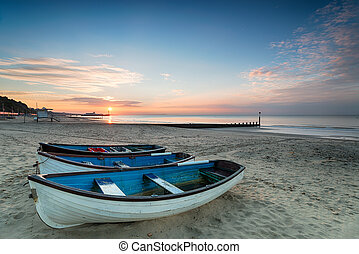 Bournemouth Beach - Beautiful sunrise over boats on the...