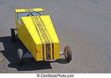 Soapbox Derby Cart Racer - A yellow soapbox derby race cart...