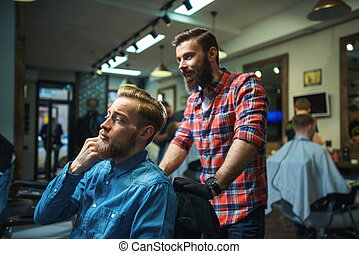 Professional occupation - Customer and hairdresser in barber...