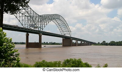 Interstate Bridge Over Mississippi - Speedboat cruises the...