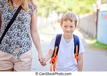 7 years old boy going to school with his mother - Little 7...