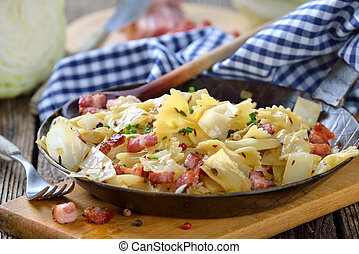 Austrian specialty - Pasta with fried white cabbage and...